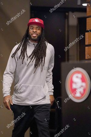 San Francisco 49ers cornerback Richard Sherman walks to the podium to speak with reporters after a practice at the team's NFL football training facility in Santa Clara, Calif.,. The 49ers will face the Kansas City Chiefs in Super Bowl 54