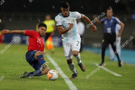 Raimundo Rebolledo, Carlos Valenzuela. Chile's Raimundo Rebolledo, left, and Argentina's Carlos Valenzuela, right, battle for the ball during a South America Olympic qualifying U23 soccer match at the Hernan Ramirez Villegas stadium in Pereira, Colombia, . Argentina won the match 2-0