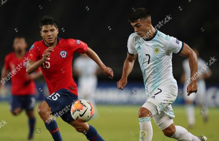 Raimundo Rebolledo, Carlos Valenzuela. Chile's Raimundo Rebolledo, left, and Argentina's Carlos Valenzuela, right, battle for the ball during a South America Olympic qualifying U23 soccer match at the Hernan Ramirez Villegas stadium in Pereira, Colombia