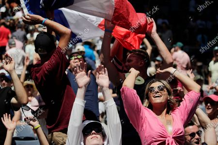 Fans cheer during the men's singles third round match between Gael Monfils of France and Ernests Gulbis of Latvia at the Australian Open Grand Slam tennis tournament in Melbourne, Australia, 25 January 2020.