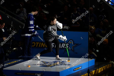 United States' Hilary Knight shoots during the Skills Competition shooting stars event, part of the NHL All-Star weekend, in St. Louis