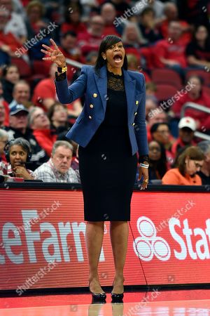 Virginia head coach Tina Thompson shouts instructions to her team during the second half of an NCAA college basketball game in Louisville, Ky., . Louisville won 71-56