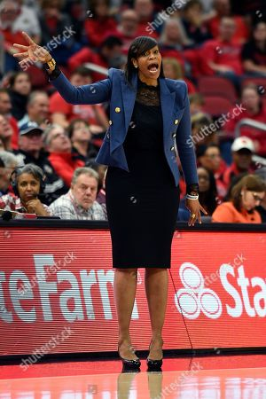 Stock Picture of Virginia head coach Tina Thompson shouts instructions to her team during the second half of an NCAA college basketball game in Louisville, Ky., . Louisville won 71-56