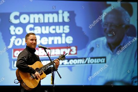 Musician Mike Posner performs for a rally for Democratic Presidential Candidate Bernie Sanders, who was not present, Friday, Jan.24, 2020, in Iowa City, Iowa