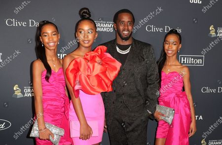Stock Photo of Sean Combs and his daughters