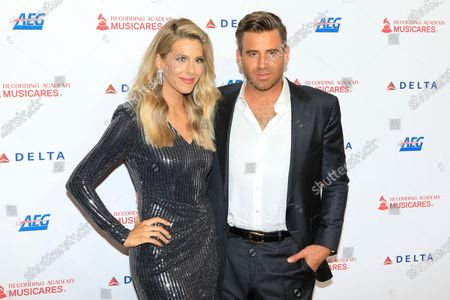 Jason Wahler (R) and his wife Ashley Wahler (L) arrive for the 2020 MusiCares Person of The Year gala at the Convention Center in Los Angeles, California, USA, 24 January 2020. MusiCares Person of the Year honored US rock band Aerosmith for their extraordinary creative accomplishments and significant philanthropic efforts over five decades.