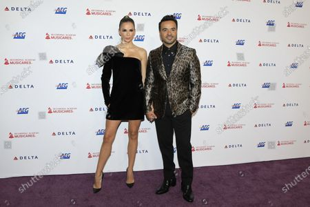 Agueda Lopez (L) and Puerto Rican musician Luis Fonsi (R) arrive for the 2020 MusiCares Person of The Year gala at the Convention Center in Los Angeles, California, USA, 24 January 2020. MusiCares Person of the Year honored US rock band Aerosmith for their extraordinary creative accomplishments and significant philanthropic efforts over five decades.