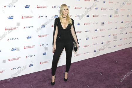CariDee English arrives for the 2020 MusiCares Person of The Year gala at the Convention Center in Los Angeles, California, USA, 24 January 2020. MusiCares Person of the Year honored US rock band Aerosmith for their extraordinary creative accomplishments and significant philanthropic efforts over five decades.