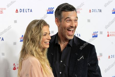 Leann Rimes and Eddie Cibrian arrive for the 2020 MusiCares Person of The Year gala at the Convention Center in Los Angeles, California, USA 24 January 2020. MusiCares Person of the Year Tribute honored US rock band Aerosmith for their extraordinary creative accomplishments and significant philanthropic efforts over five decades.