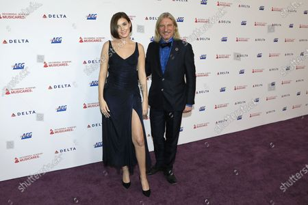 Stock Picture of Nathalie Volk arrives with German businessman Frank Otto for the 2020 MusiCares Person of The Year gala at the Convention Center in Los Angeles, California, USA 24 January 2020. MusiCares Person of the Year Tribute honored US rock band Aerosmith for their extraordinary creative accomplishments and significant philanthropic efforts over five decades.