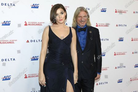 Nathalie Volk arrives with German businessman Frank Otto for the 2020 MusiCares Person of The Year gala at the Convention Center in Los Angeles, California, USA 24 January 2020. MusiCares Person of the Year Tribute honored US rock band Aerosmith for their extraordinary creative accomplishments and significant philanthropic efforts over five decades.