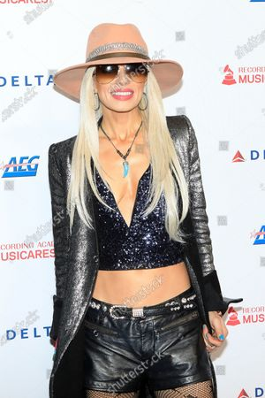 Orianthi arrives for the 2020 MusiCares Person of The Year gala at the Convention Center in Los Angeles, California, USA 24 January 2020. MusiCares Person of the Year Tribute honored US rock band Aerosmith for their extraordinary creative accomplishments and significant philanthropic efforts over five decades.
