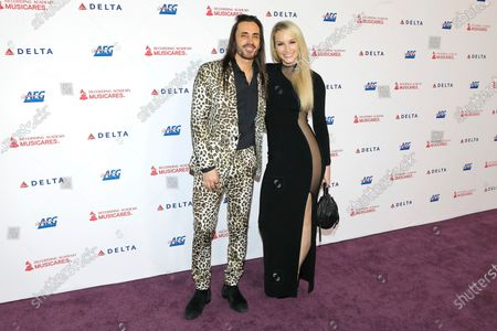 Nuno Bettencourt and Christina Chandler arrive for the 2020 MusiCares Person of The Year gala at the Convention Center in Los Angeles, California, USA 24 January 2020. MusiCares Person of the Year Tribute honored US rock band Aerosmith for their extraordinary creative accomplishments and significant philanthropic efforts over five decades.