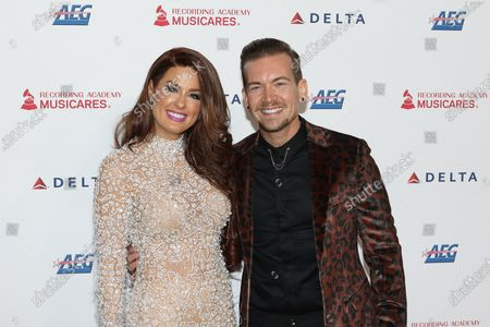 Stock Picture of Hilary Roberts (L) and US Producer Damon Sharpe (R) arrive for the 2020 MusiCares Person of The Year gala, at the Convention Center in Los Angeles, California, USA, 24 January 2020. MusiCares Person of the Year Tribute honored US rock band Aerosmith for their extraordinary creative accomplishments and significant philanthropic efforts over five decades.