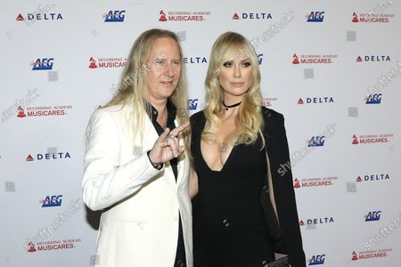 Jerry Cantrell (L) and US fashion model CariDee English arrive for the 2020 MusiCares Person of The Year gala, at the Convention Center in Los Angeles, California, USA, 24 January 2020. MusiCares Person of the Year Tribute honored US rock band Aerosmith for their extraordinary creative accomplishments and significant philanthropic efforts over five decades.