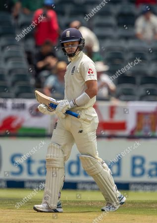 England's batsman Jos Buttler leaves the field after being bowled by South Africa's bowler Anrich Nortje for 56 runs on day two of the fourth cricket test match between South Africa and England at the Wanderers stadium in Johannesburg, South Africa