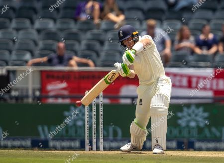 England's batsman Jos Buttler plays a shot on day two of the fourth cricket test match between South Africa and England at the Wanderers stadium in Johannesburg, South Africa