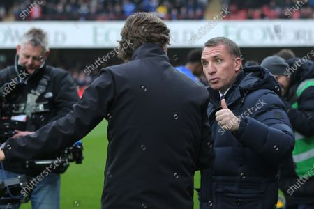 Leicester Manager, Brendan Rogers gives Brentford Head Coach, Thomas Frank the thumbs up ahead of kick-off during Brentford vs Leicester City, Emirates FA Cup Football at Griffin Park on 25th January 2020