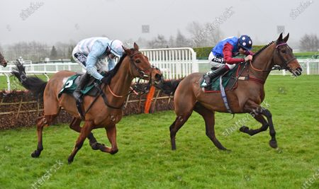 (R) Paisley Park (Aidan Coleman) takes the last before going on to win The galliardhomes.com Cleeve Hurdle Race from (L) Summerville Boy (Jonathan Burke).