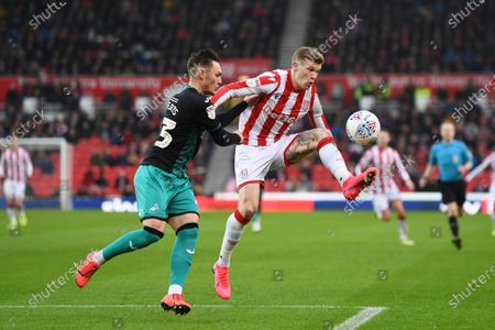 Connor Roberts of Swansea City challenges James McClean of Stoke City.