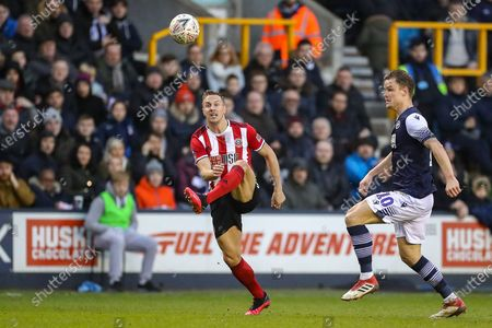 Sheffield United defender Phil Jagielka (15) look to clear the ball during The FA Cup match between Millwall and Sheffield United at The Den, London