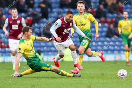 Burnley midfielder Aaron Lennon (25) tackled by the opponent during the The FA Cup match between Burnley and Norwich City at Turf Moor, Burnley