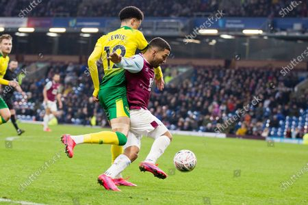 Stock Image of Burnley midfielder Aaron Lennon (25) tackled by Norwich City defender Jamal Lewis (12) during the The FA Cup match between Burnley and Norwich City at Turf Moor, Burnley