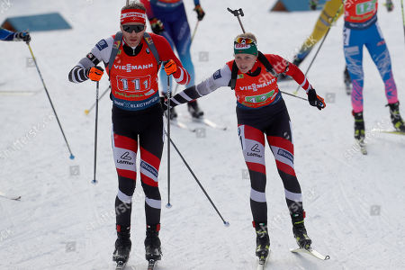 Simon Eder of Austria, left and Lisa Theresa Hauser of Austria compete at the Single Mixed Relay 6 km / 7,5 km competition at the biathlon World Cup in Pokljuka, Slovenia