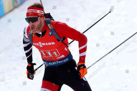 Simon Eder of Austria competes at the Single Mixed Relay 6 km / 7,5 km competition at the biathlon World Cup in Pokljuka, Slovenia