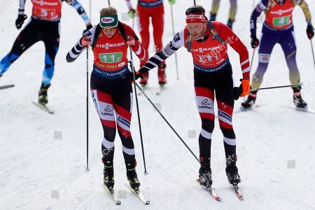 Lisa Theresa Hauser of Austria, left and Simon Eder of Austria compete at the Single Mixed Relay 6 km / 7,5 km competition at the biathlon World Cup in Pokljuka, Slovenia