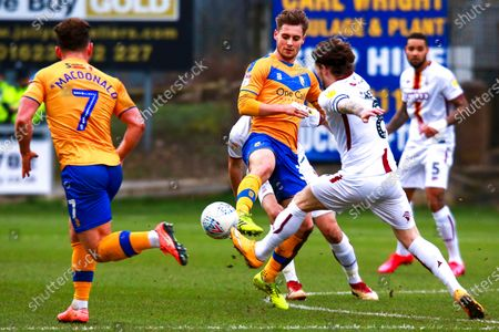 Danny Rose of Mansfield Town passes the ball out wide to Alex MacDonald of Mansfield Town