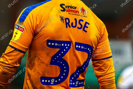 Stock Picture of Shirt letter print comes away on the shirt of Danny Rose of Mansfield Town