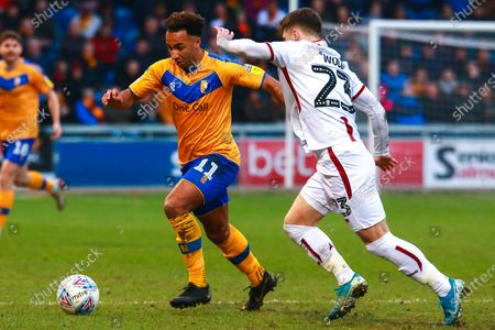 Stock Image of Nicky Maynard of Mansfield Town looks to get past Connor Wood of Bradford City