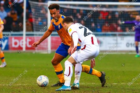 Nicky Maynard of Mansfield Town looks to get past Connor Wood of Bradford City