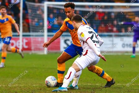Stock Picture of Nicky Maynard of Mansfield Town looks to get past Connor Wood of Bradford City