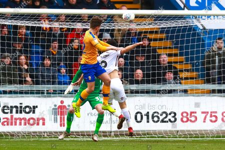 Stock Photo of Danny Rose of Mansfield Town heads at goal to give his side the lead