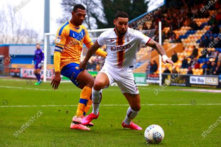 Ben Richards-Everton of Bradford City holds off pressure from Krystian Pearce of Mansfield Town