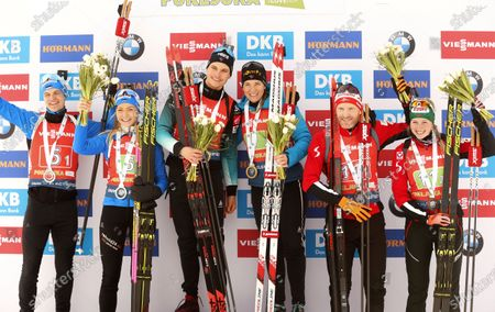 (L-R) Second placed Rene Zahkna and Regina Oja of Estonia, winners Emilien Jacquelin and Anais Bescond of France  and third placed Simon Eder and Lisa Theresa Hauser of Austria celebrate on the podium after the Single Mixed Relay competition of the Biathlon World Cup at Pokljuka Mount, Slovenia, 25 January 2020.