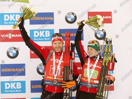 (L-R)  Third placed Simon Eder and Lisa Theresa Hauser of Austria celebrate after the Single Mixed Relay competition of the Biathlon World Cup at Pokljuka Mount, Slovenia, 25 January 2020.