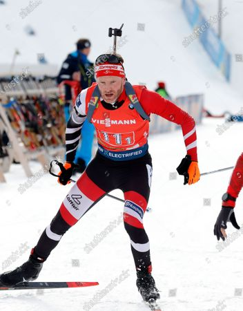 Simon Eder of Austria in action during the Single Mixed Relay competition of the Biathlon World Cup at Pokljuka Mount, Slovenia, 25 January 2020.