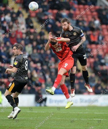 Newport's Mark O'Brien clears from Orient's Conor Wilkinson.