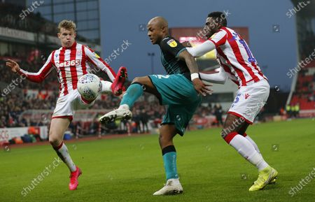 Stock Photo of Andre Ayew of Swansea and James McClean of Stoke City and Bruno Martins Indi of Stoke City
