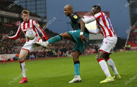 Andre Ayew of Swansea and James McClean of Stoke City and Bruno Martins Indi of Stoke City