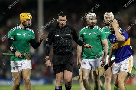 Tipperary vs Limerick. Limerick's Tom Morrissey, Tom Condon and Tipperrary's Willie Connors with referee Patrick Murphy
