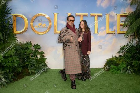 Robert Downey Jr, Susan Downey. Actor Robert Downey Jr, and producer Susan Downey, pose for photographers upon arrival at a screening for 'Dolittle' in London