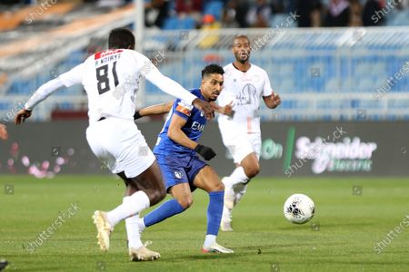 Al-Hilal's Salem Aldossari (R) in action against Al-Shabab's Alfred N'Diaye (L) during the Saudi Professional League soccer match between Al-Hilal and Al-Shabab at Prince Faisal bin Fahd Stadium, Al-Ridah, Saudi Arabia, 25 January 2020.