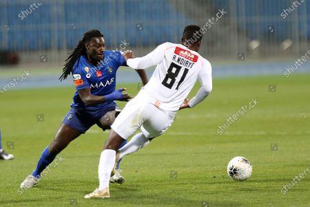 Al-Hilal's Bafetimbi Gomis (L) in action against Al-Shabab's Alfred N'Diaye (R) during the Saudi Professional League soccer match between Al-Hilal and Al-Shabab at Prince Faisal bin Fahd Stadium, Al-Ridah, Saudi Arabia, 25 January 2020.