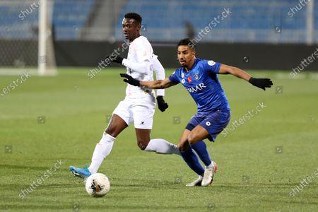 Al-Hilal's Salem Aldossari (R) in action against Al-Shabab's Hassan Muath Fallatah (L) during the Saudi Professional League soccer match between Al-Hilal and Al-Shabab at Prince Faisal bin Fahd Stadium, Al-Ridah, Saudi Arabia, 25 January 2020.