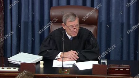 In this image from United States Senate television, Chief Justice of the US John G Roberts Jnr, Jr. presides during today's session of the impeachment trial of President Trump in the US Senate in the US Capitol.