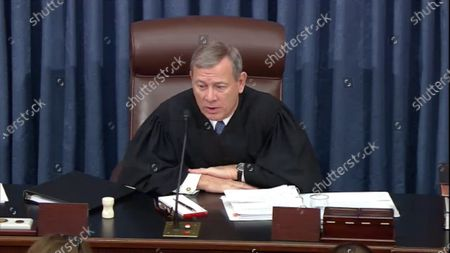 In this image from United States Senate television, Chief Justice of the US John G Roberts Jnr, Jr. grants the motion to adjourn during the President's impeachment trial of President Trump in the Senate in the US Capitol.